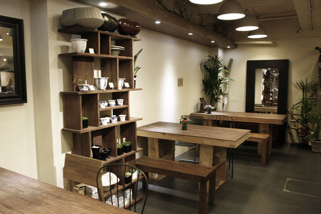 Shelves and tables made of wooden crates.