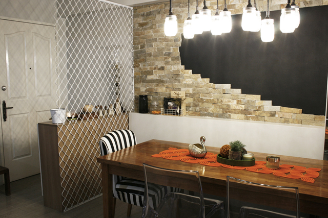 The dining room with a solid wooden table that balanced off the stone wall.